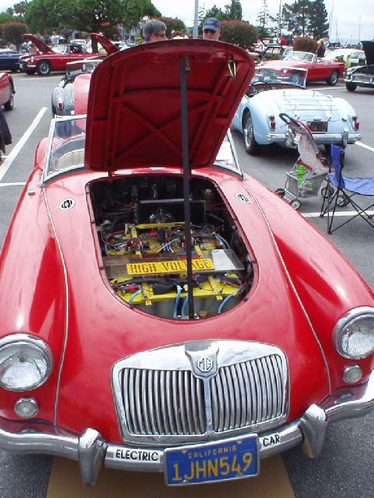 "This MGA was converted to electric in 1999, and has a range of 40-50 miles on a single charge in addition to having a top speed of about 65 mph. The owner claimed he had ""the only British car that does not leak oil"" (though Bob Stine would later make that claim...)"