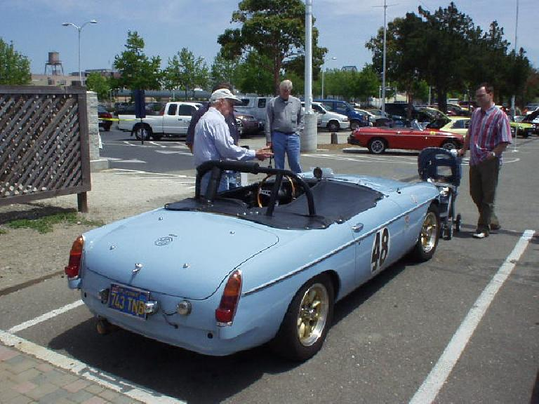 David Wright talking to a chap by his blue vintage MGB racer.