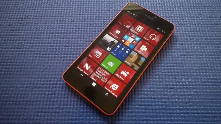 orange Microsoft Lumia 640 XL, blue yoga mat