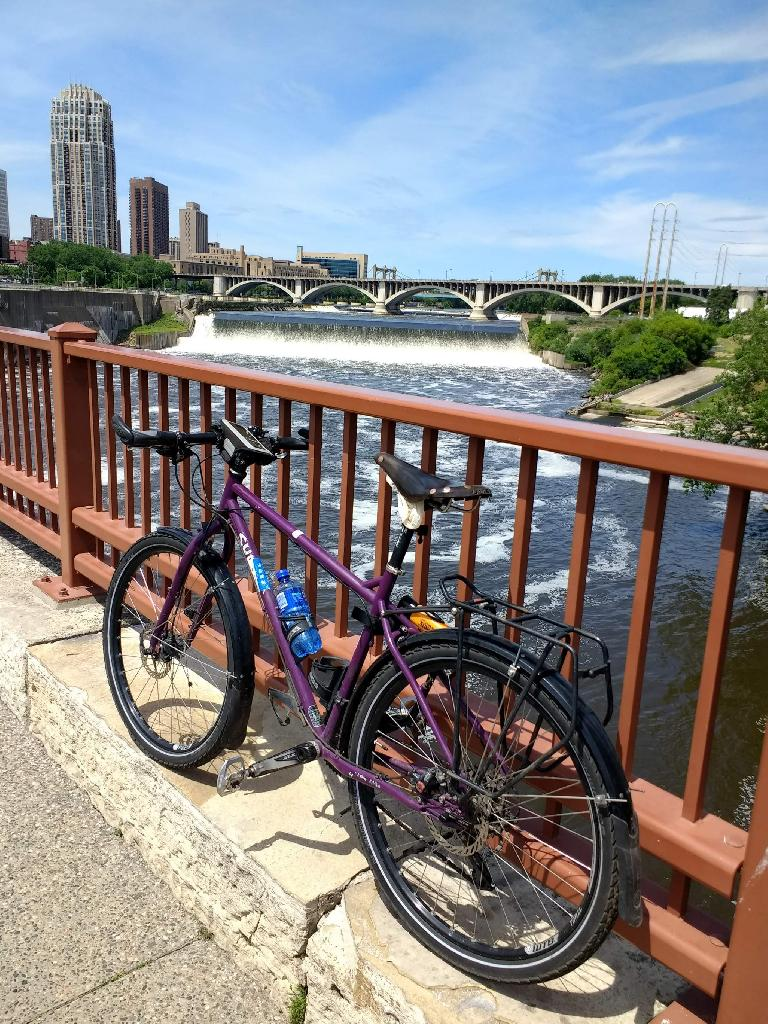 My buddy Dan's purple Surly in front of the Stone Arch Bridge. He generously lent it to me so I could explore Minneapolis while he was at work.