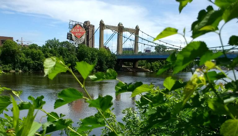 Grain Belt Beer sign by a bridge over the Mississippi River in Minneapolis.
