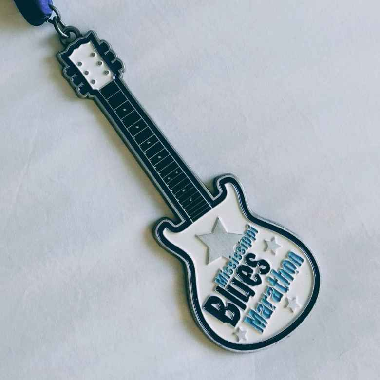 The medal for the 2019 Mississippi Blues Marathon was of a guitar.