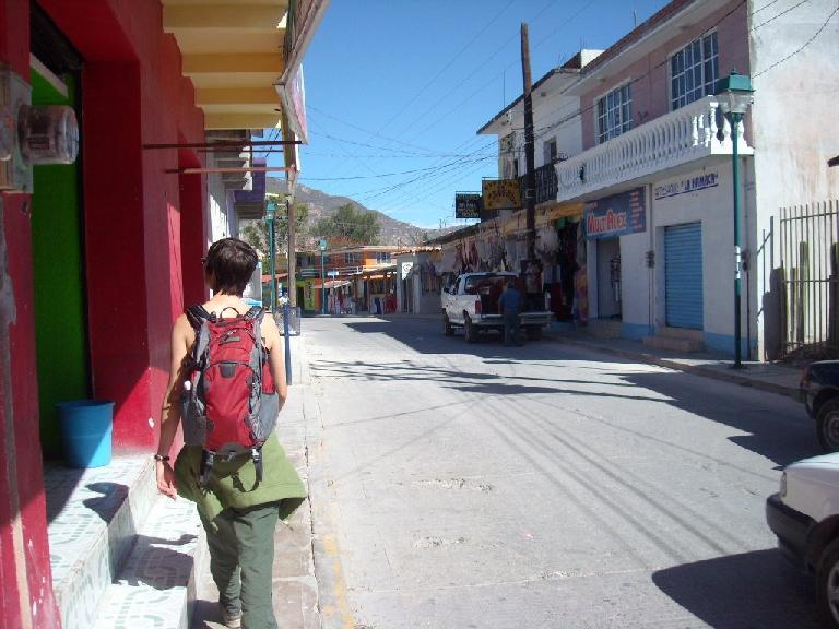 Sarah walking down the main street in Mitla.