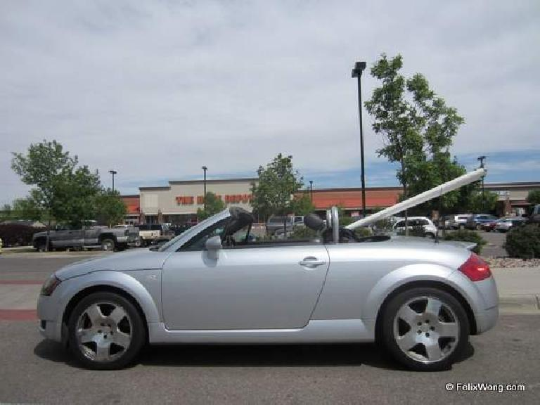 silver 2001 Audi TT Roadster carrying PVC pipe, Home Depot
