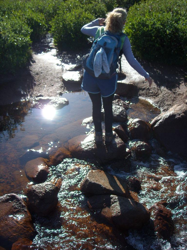 Julie crossing a stream.