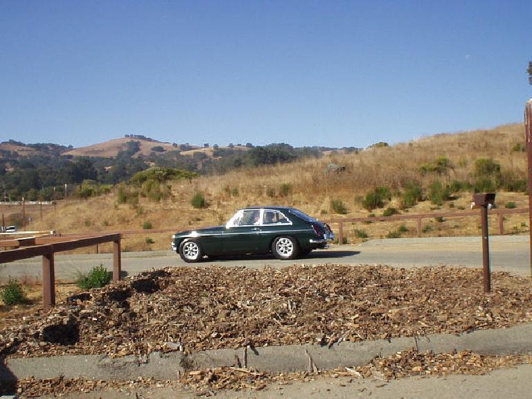 A dark green MGB GT following.