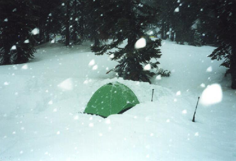 Snow camping.  We built snow walls around the tent to help shield it from the wind.  The snow really came down during the night.