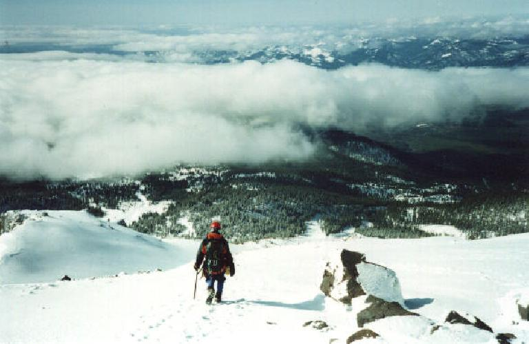 Following Richard back down the mountain, to the level of the clouds.  Nice views abound! (March 25, 2001)