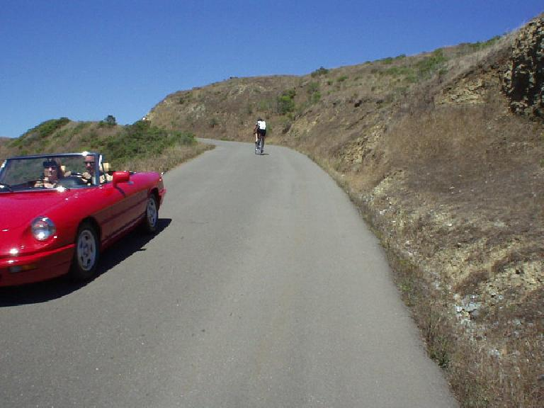 [Mile 128, 2:44pm] Here we go, up Coleman Rd!  It probably gets up to 13-14% grade in some sections, and is moderately long.  Seeing this beautiful Alfa Romeo Spider (just like Elaina but in Alfa red) come on down lifted my spirits.
