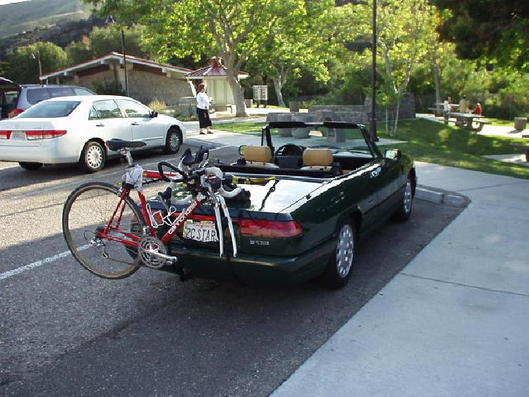 Another long road trip for the Alfa Romeo!  Here she is with my little race bike, taking a short break at a rest stop just north of Santa Barbara. (April 16, 2004)