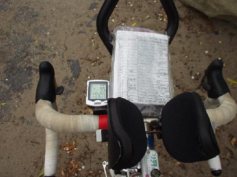 "[Mile 55, 9:37am] Canny's ""navigation system"": map, cyclometer, compass, thermometer, and armrests."