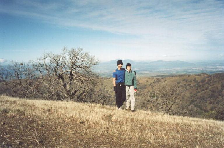 Felix Wong and Sarah on Rose Peak, the highest summit in Alameda County, with Mt. Diablo in the background, the highest summit in Contra Costa County! (January 27, 2002)