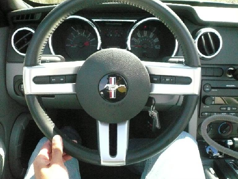 This is my nomination for the best-looking steering wheel in the business, which has metal-covered spokes and an airbag.