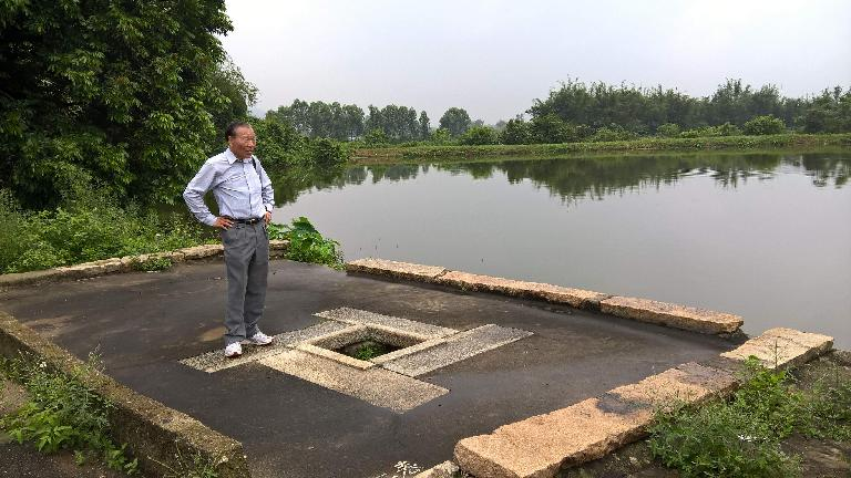 My dad and an old well by the pond he used to swim in as a kid.