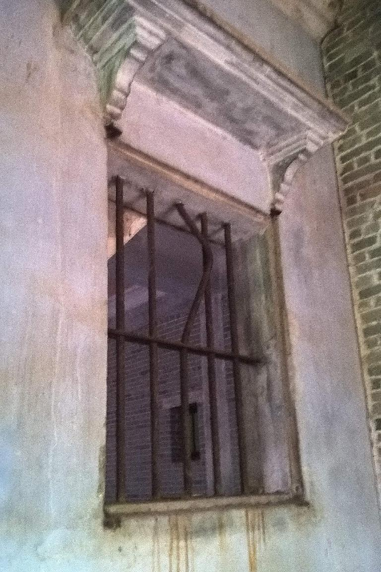 Japanese soldiers had pried open the bars of this window in my dad's cousin Stephen's house which was adjacent to his.