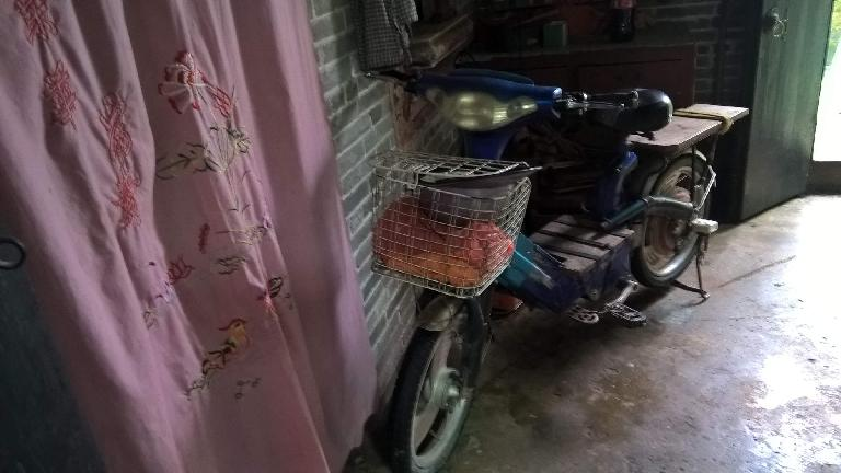The villager had an old motorbike.