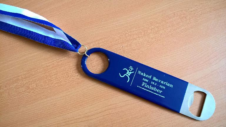 2016 Naked Bavarian Marathon finisher medal, beer bottle opener
