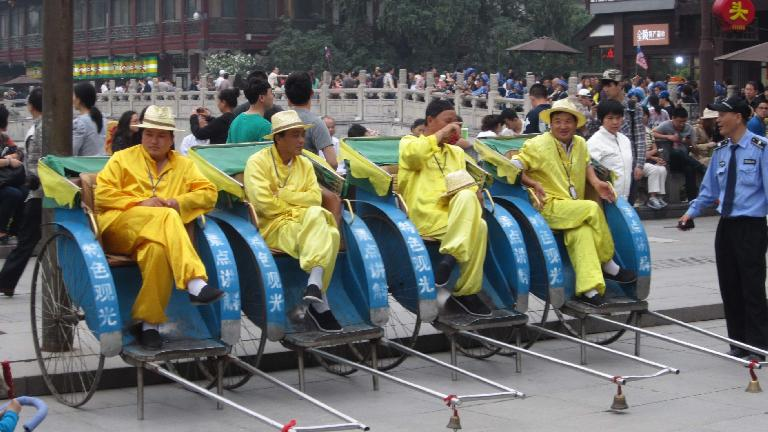 Guys on carriages near the Confucius Temple.