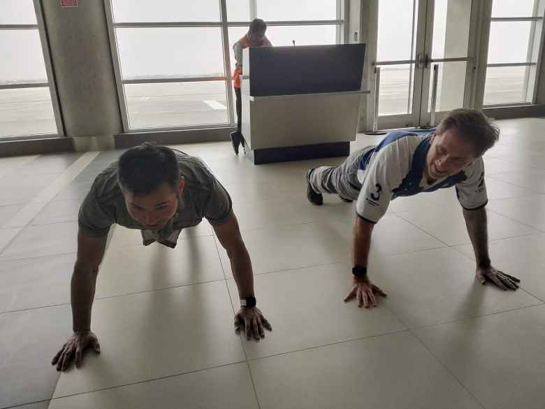 Felix and Matthew doing push-ups inside the Pisco Airport.