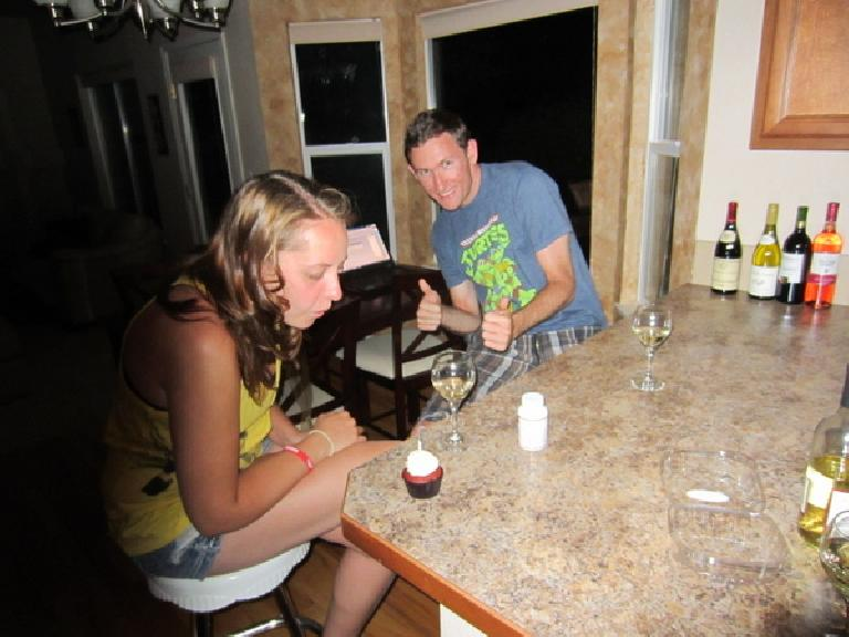 Kelly blows out a candle on her birthday cupcake as Tim looks on. (June 18, 2012)