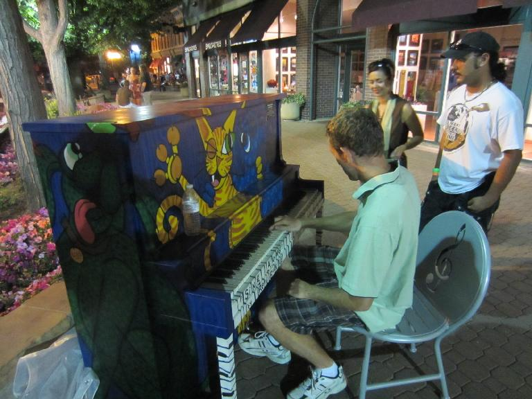 Tim playing some Coldplay on one of the pianos in Old Town Square during Tia and Jon's visit. (June 23, 2012)