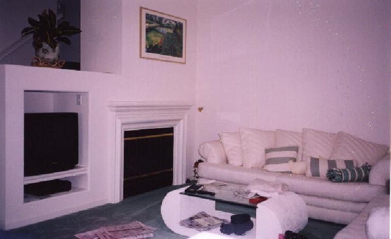 The living room.  It has a gas fireplace and a built in place for the TV.