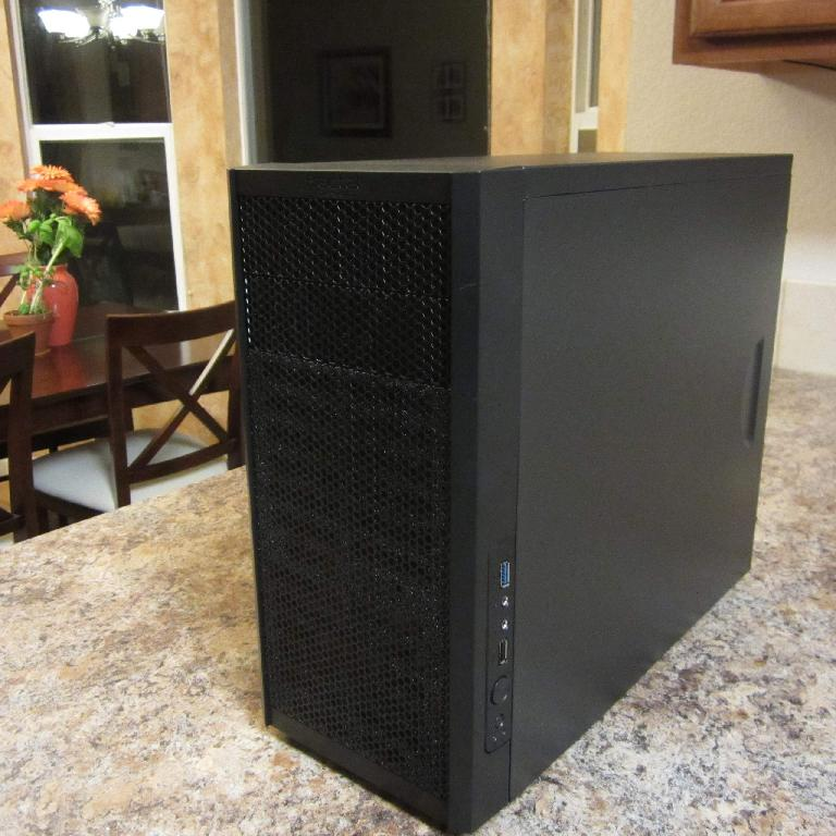 The Fractal Design Core 1000 USB 3.0 MicroATX Mid Tower case with all components installed inside.