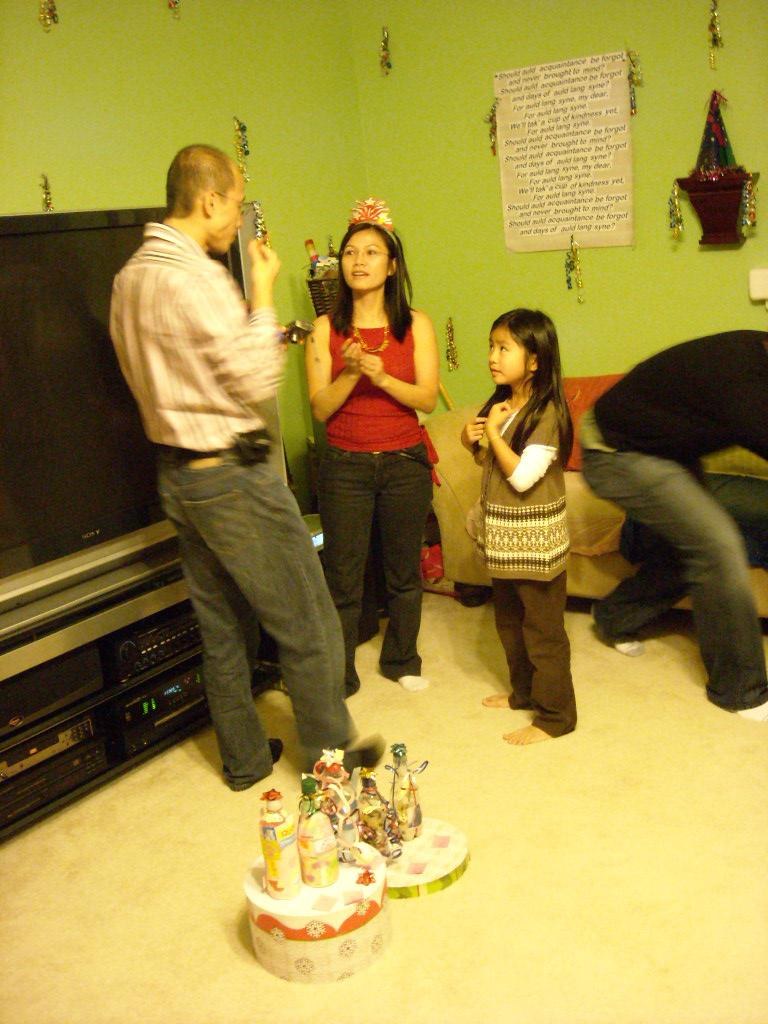 """Thai and Susan talking while a kid hopes she won the """"best decorated bottle"""" contest."""
