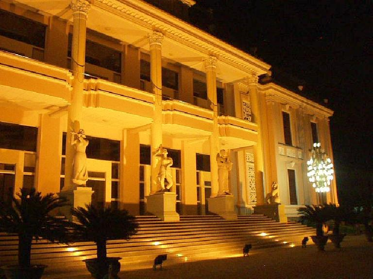 The theatre, at night.