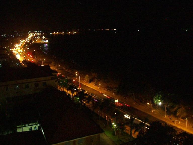Nighttime view of Nha Trang from the balcony of our room across from the beach. (July 14, 2006)