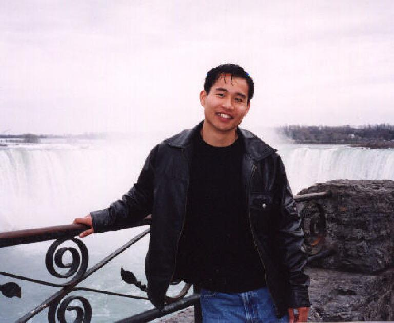 Felix Wong in front of the Falls, enjoying the view immensely.