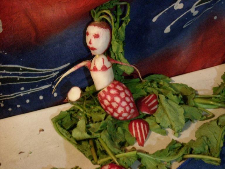 A mermaid radish carving.