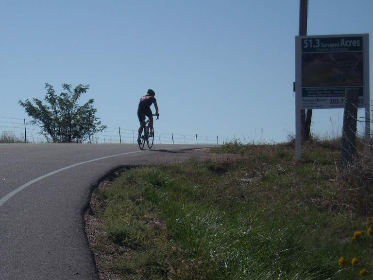 Celeste (I think) cresting a hill not too far from Longmont.