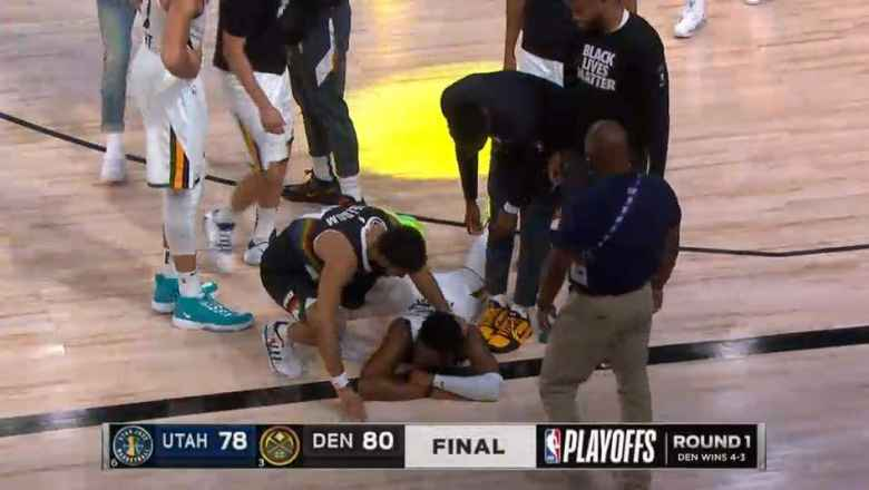 Bodies strewn on the floor at the end of the Utah vs. Denver Game 7 of the 2020 NBA playoffs.