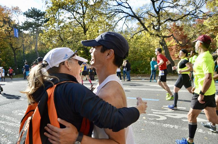 [Mile 24.2] Bev Benzon, an old friend from the Tri-City Triathlon Club, giving Felix Wong a hug at the 2016 New York City Marathon.