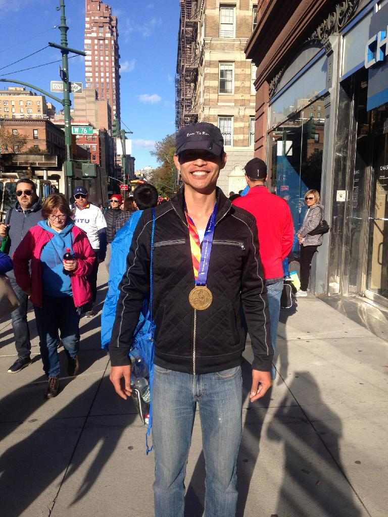 Felix Wong is all smiles after finishing the 2016 New York City Marathon.