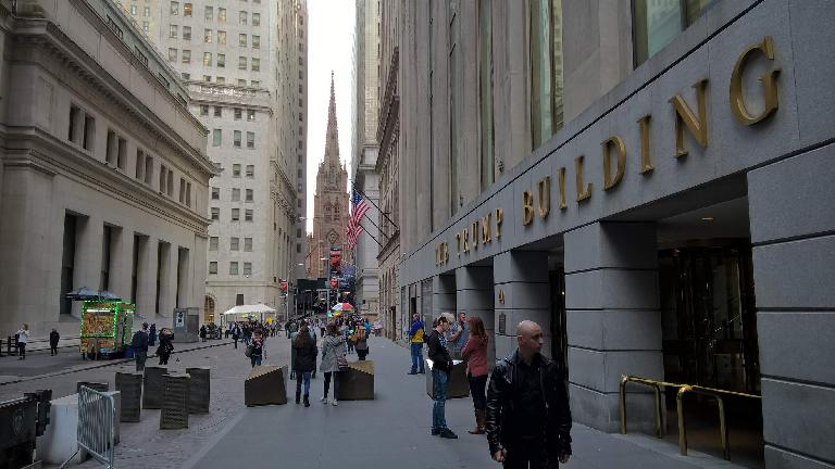 The Trump Building on 40 Wall St., with Trinity Church in the background.