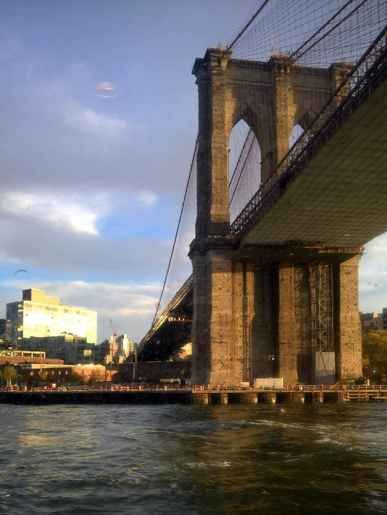 The Brooklyn Bridge as viewed from a ferry boat.