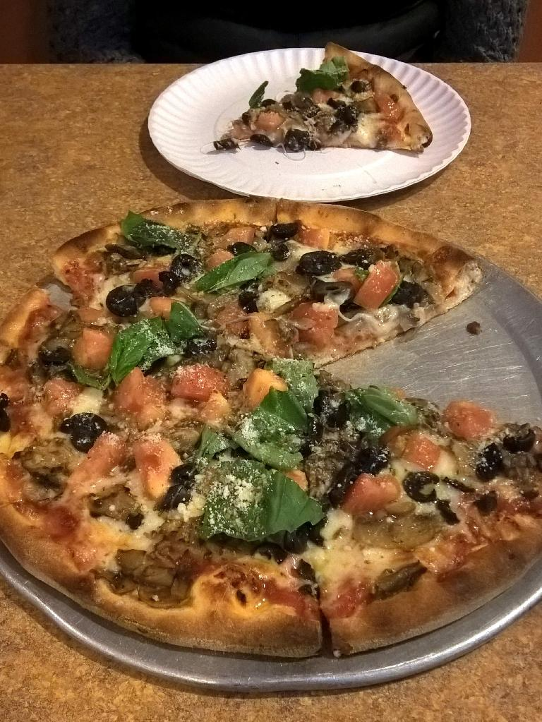 New York Style pizza at Stage Coach Pizza. This one had spinach, olives, and tomatoes and was very delicious.