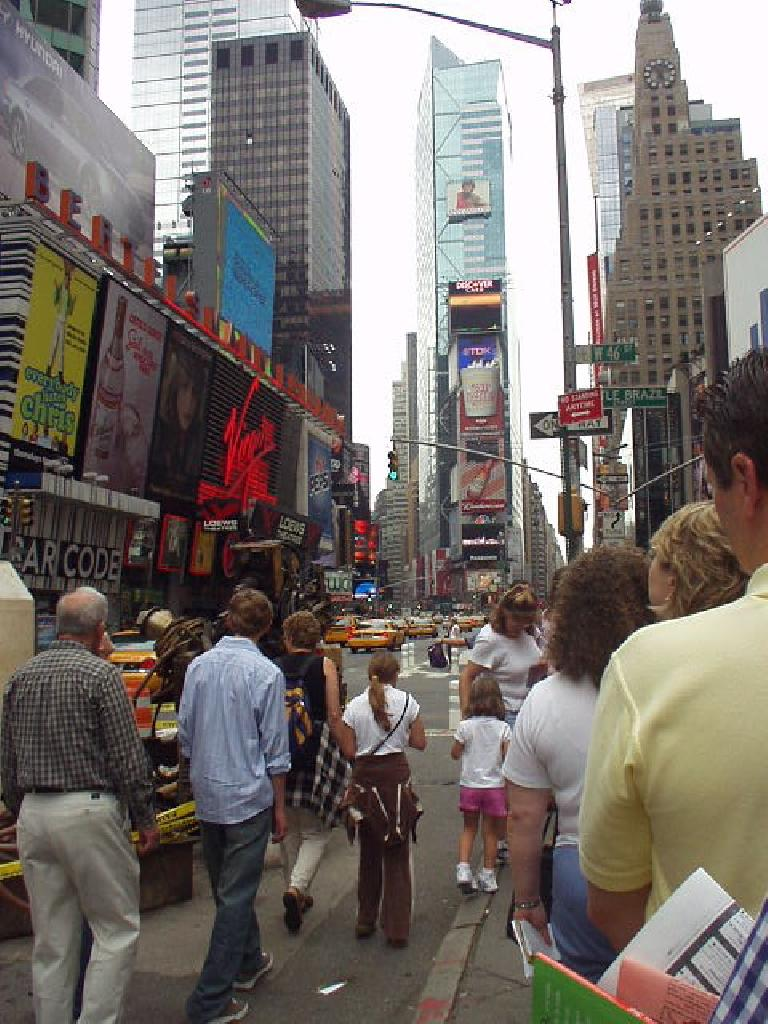 """The commercialism at Times Square is almost overwhelming.  Here we stand in line for Broadway tickets (we saw """"Rent"""")."""