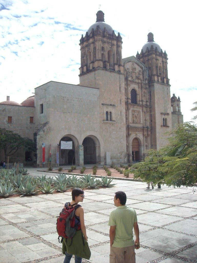 Sarah and a Mexican tourist named Manuel in front of La Iglesia de Santo Domingo.