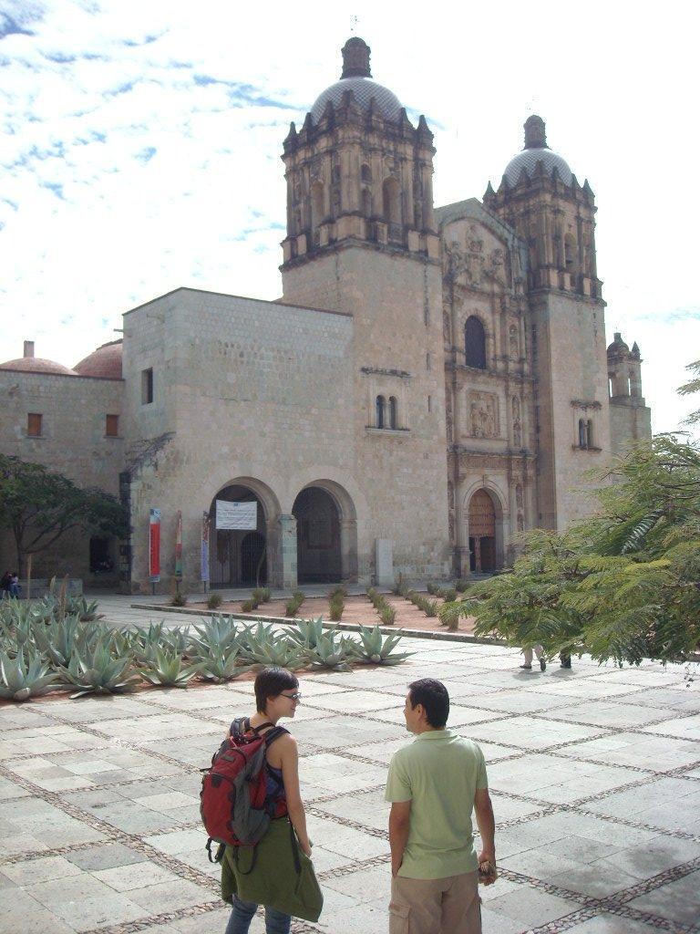 Sarah and a Mexican tourist named Manuel in front of La Iglesia de Santo Domingo.