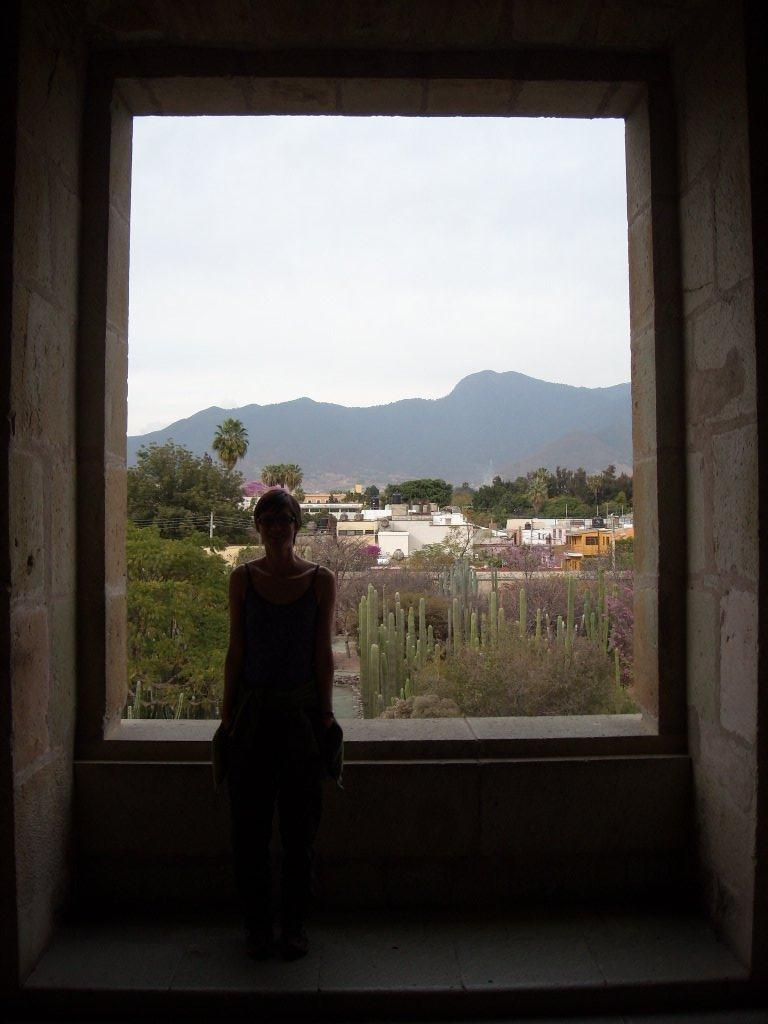 Sarah inside the museum at La Iglesia de Santo Domingo, with the Botanical Gardens (and mountain views) outside.