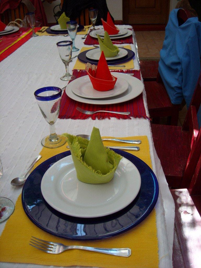 Colorful placemats and napkins at the table.