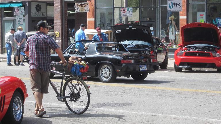 black Porsche 914 driving down Walnut Street in downtown Fort Collins
