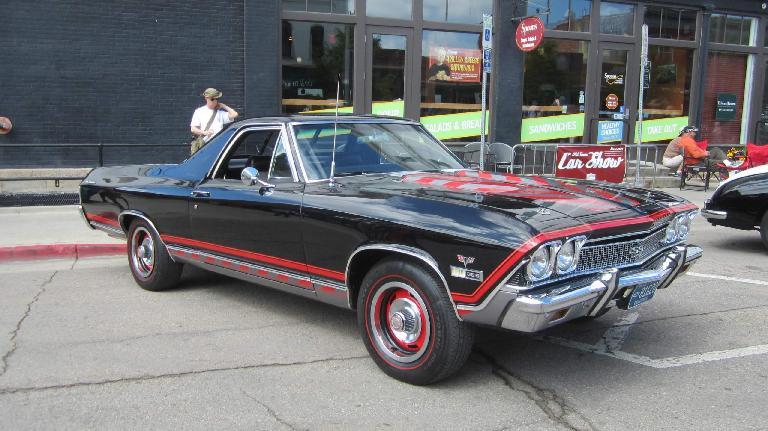 black Chevrolet El Camino with red stripe