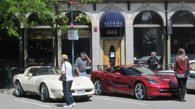 white 1970s era Corvette Coupe with dark red 2015 Corvette Stingray