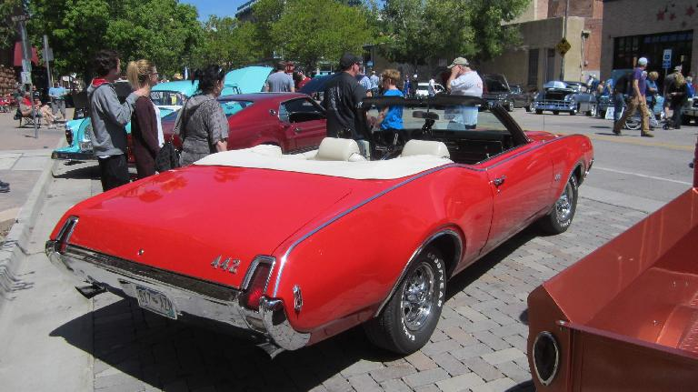 red Oldsmobile 442 convertible