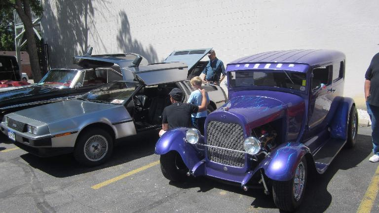 silver Delorean, purple hot rod coupe