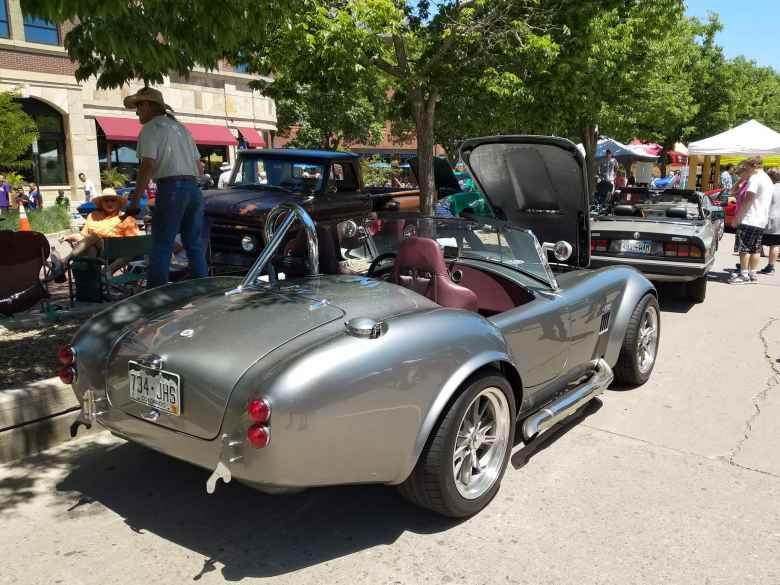 A silver Shelby Cobra kit car.